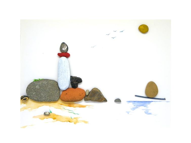 cuadro costero hecho con piedras