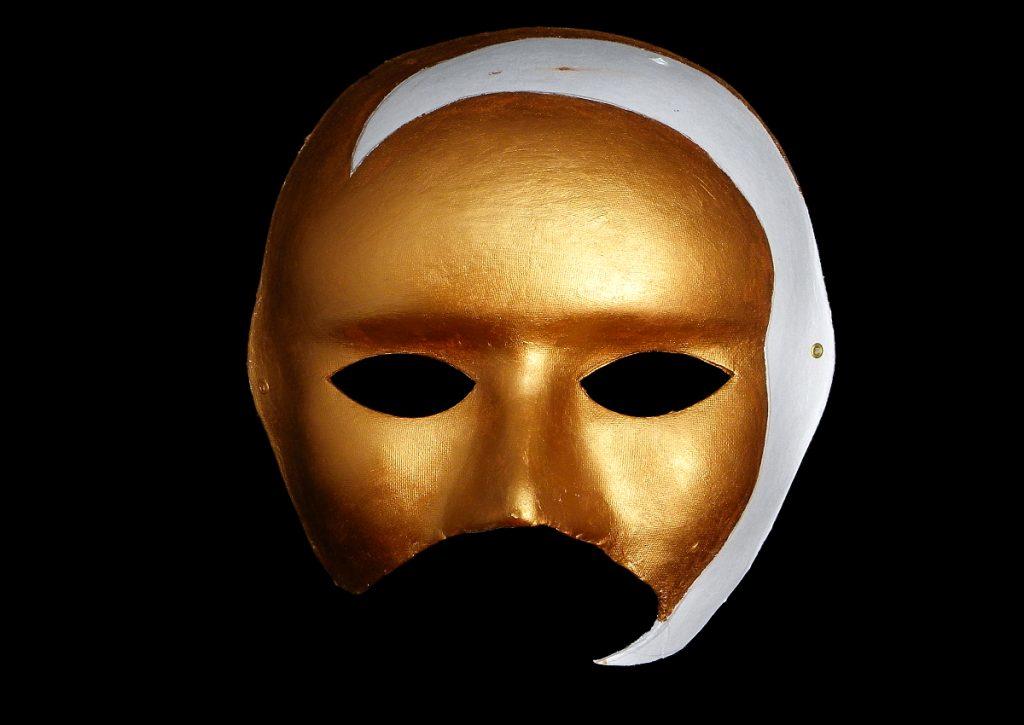 parte de la mascara veneciana pintada de color cobre metalizado