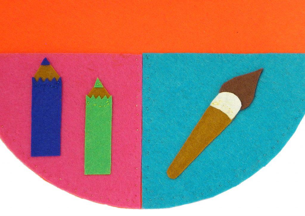 figuras de fieltro para clasificar pinceles y lapiceros en el organizador de pared