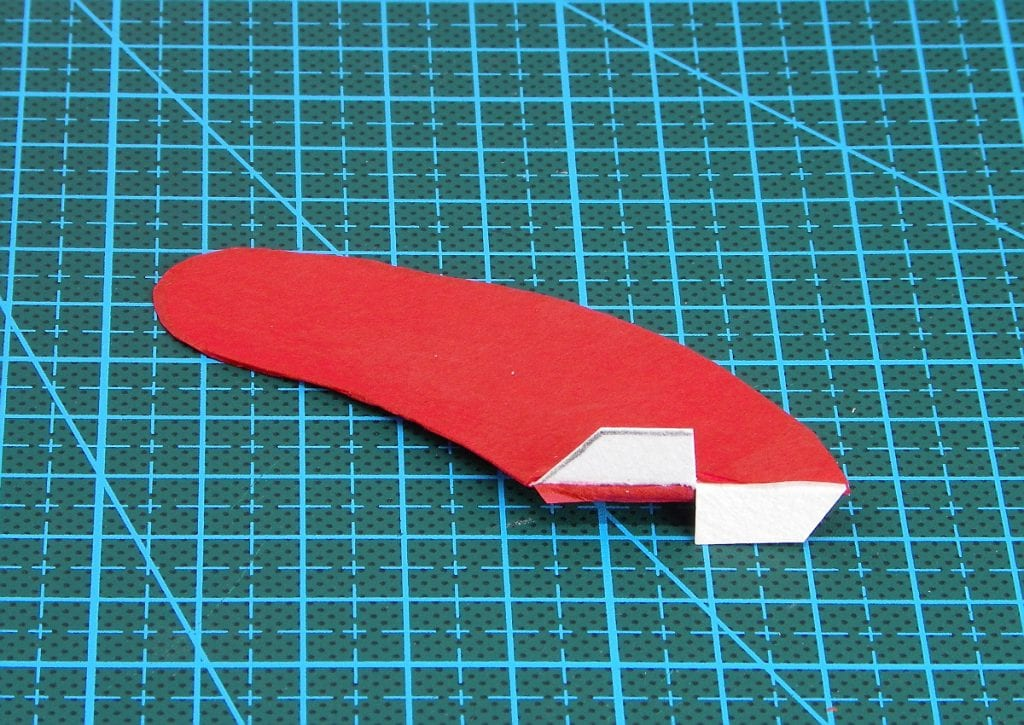 aleta del cohete de tintin hecha de cartulina y cubierta por papel de seda y las pestañas