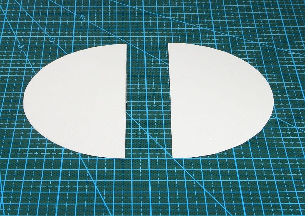 circulo de cartulina dividido en dos para hacer piezas del cohete de tintin