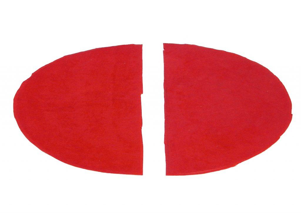 circulo de cartulina dividido en dos partes y cubierto por papel de seda rojo para hacer piezas cohete tintin