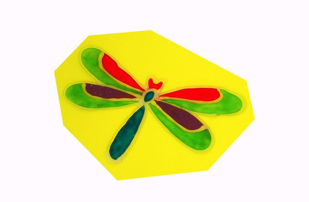 adorno de una libelula hecho con silicona caliente y pinturas para cristal con estilo lamparas de tiffany