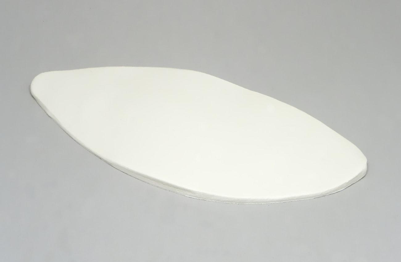 cubo de pasta aplastado y expandido con rodillo de modelar