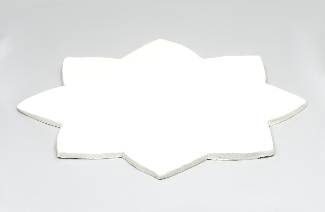 estrella hecha con pasta para modelar para hacer candelero